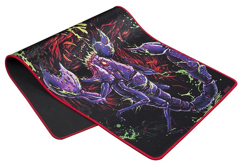 Коврик для мыши Marvo Scorpion G23Игровой коврик Marvo G23 изготовлен из ткани гладкого плетения, которая обеспечивает быстрое скольжение мыши и надежное отслеживание сенсора. Основание из высококачественной резины надежно удерживает коврик на столе даже в самых горячих игровых сражениях. Коврик имеет износостойкие прошитые края и его можно сворачивать для переноски.<br>